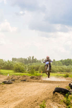 off track: Biskupice Radlowskie, Poland - June 5, 2016: Motocross rider coming off a jump on the track.