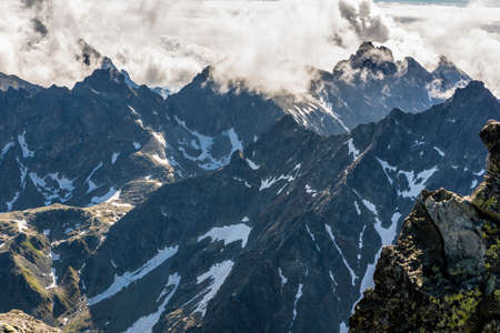 tatra: Clouds billowing over the peaks of the Tatra Mountains.