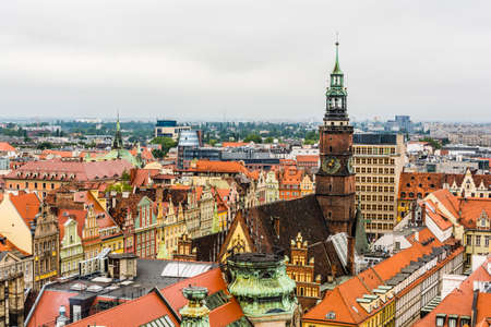 tenement buildings: Wroclaw, Poland - August  05, 2016: Town Hall Tower dominates the houses around the market square. Editorial