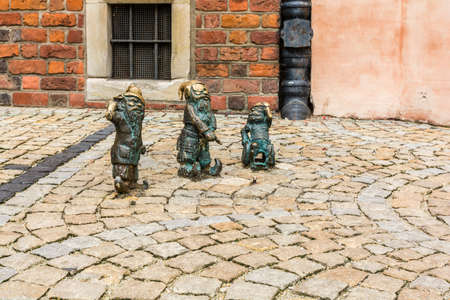 dwarfs: Wroclaw, Poland - August  05, 2016: Three figurines of dwarfs (Wroclaw?s dwarfs).