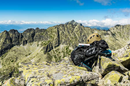 gully: Guide book, helmet and backpack in the mountains.