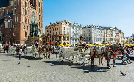 assumed: Krakow, Poland - August  26, 2016: Fiacre waiting to transport tourists.
