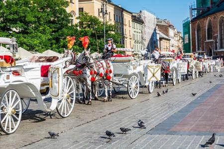 staging: Krakow, Poland - August  26, 2016: Staging white droshky on the Main Market.