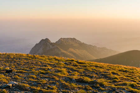 giewont: Giewont massif seen in the morning mist. Stock Photo
