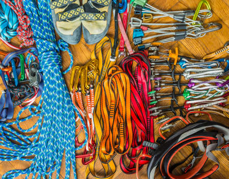 descender: Climbing equipment (rack gear, hardware) needed for belaying in the mountains and rocks.  Stock Photo