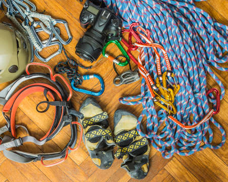 descender: Equipment for rock climbing and camera ready for packaging.