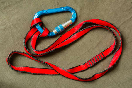 Knot (Cow hitch) tied with tape on the carabiner.