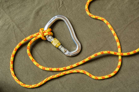Knot (Girth hitch) tied with cord to the carabiner.