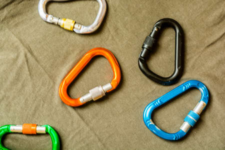 Multi-colored screw carabiners used in rock climbing and mountaineering.