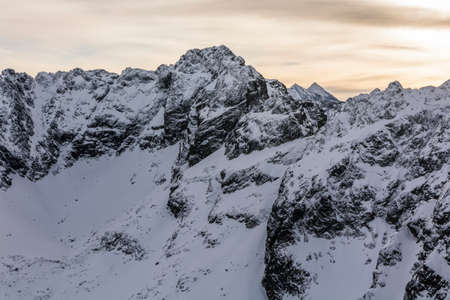 orla: Snow covers the Tatra ridge view of the fragment Orla Perc (Eagles Path)