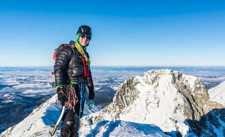 Mountaineer in the winter at the top.