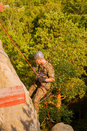 descender: Szczytna, Poland - July 10, 2013: Soldier of the Polish army during the exercises from the rope ride. Editorial