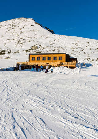 Strbske Pleso, Slovakia - February 07, 2015: Cottage under Soliskom (Chata pod Soliskom) and tourists in the winter season. Editorial