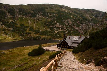 Karpacz, Poland - August 24, 2012: Mountain cottage (Samotnia) on the Small Pond in the Giant Mountains. Editorial