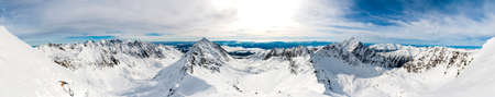 tatra: Valleys separated by mountain ridges as seen during the winter - Wide panorama. Stock Photo
