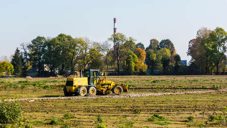 Niedomice, Poland - October 19, 2017: Grader on the construction site. Editorial