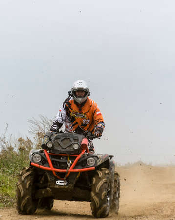 motorcross: Biskupice Radlowskie, Poland - October 22, 2017: The man riding a leisure quad on the road. Editorial