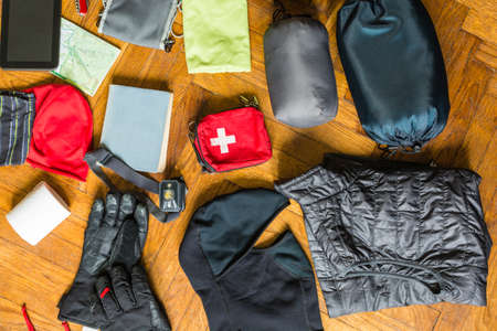 Preparation of the basic things to pack a backpack on a hiking trip and overnight stay in a mountain shelter.