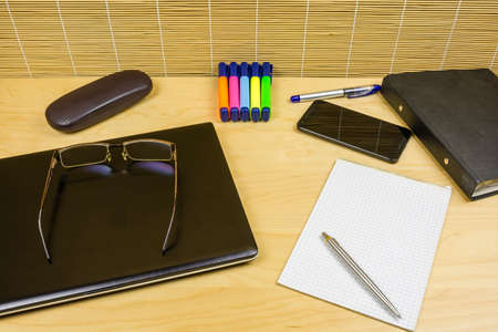 Wooden desk with accessories that you need for efficient office work.