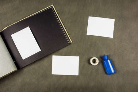 Prepared new images for pasting with glue or tape to a photo album in retro style. Stock Photo