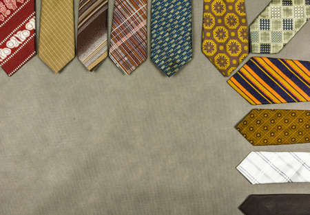 Half-frame with a set of ties in various patterns and widths.
