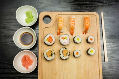 Food straight from Japan or sushi on a dark table.