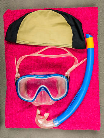 Childrens diving set in the indoor swimming pool with towel.