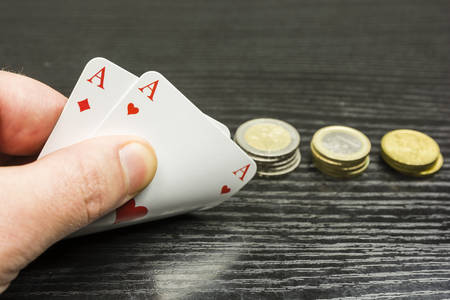 Poker game - the player receives two aces - you can bet.