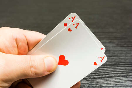 Two aces (Hearts and Tiles) in the hand held.