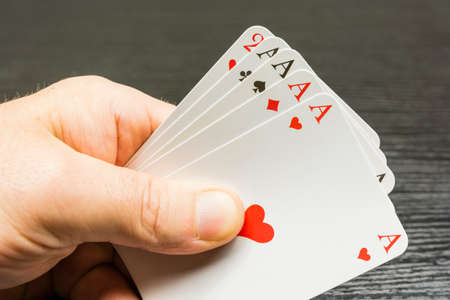 A game of poker. Four of a kind on the hand with aces.