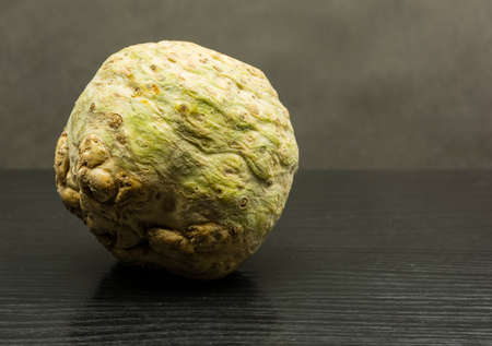 Fresh celery root on a wooden table.