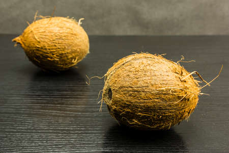 Coconut put on a wooden dark table.