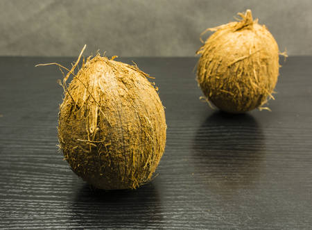 Fruit palm - coconut on a wooden dark table.
