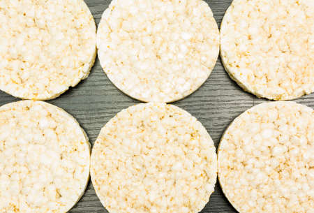 A group of rice cakes spread out as a background.