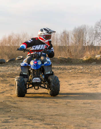Biskupice Radlowskie, Poland - January 14, 2018: Young adept steering training a ride on a small quad. Editorial