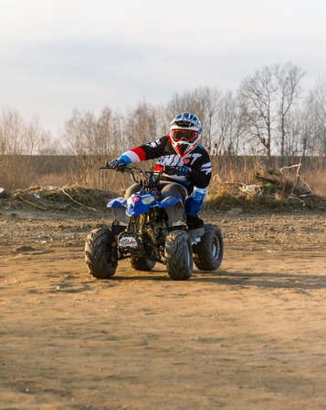 Biskupice Radlowskie, Poland - January 14, 2018: Young adept steering wheel on a small quad.