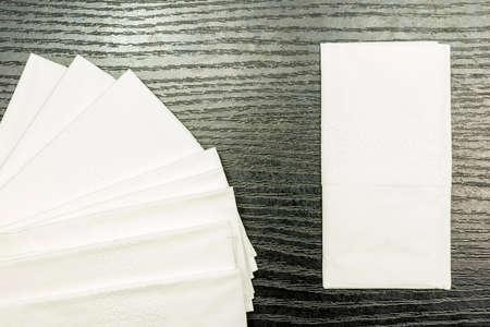 Soft paper handkerchief on a dark basis.