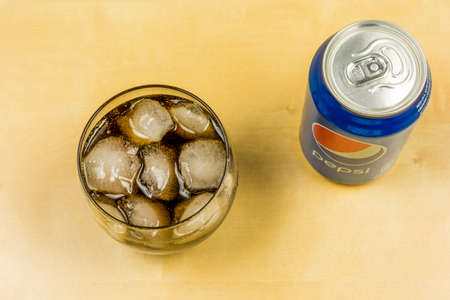 Niedomice, Poland - March 09, 2018: Top view on Pepsi in a glass with ice cubes.