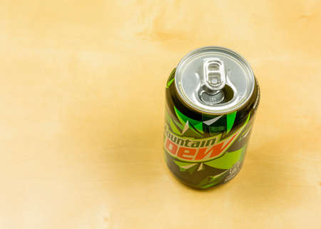 Niedomice, Poland - March 09, 2018: Open can with carbonated drink Mountain Dew. Editorial