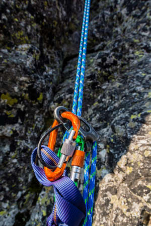 End of climbing. Rappel down on the climbing rope using a descender. Stock fotó - 110974655
