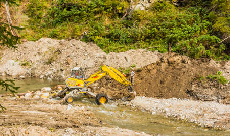 Pribylina, Slovakia - October 14, 2018: Walking excavators - Menzi Muck A91. Used in the river for earthworks.