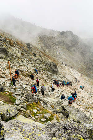 Palenica Bialczanska, Poland - September 08, 2018: Crowds of tourists heading up to the popular Rysy peak. Tatra Mountains. Publikacyjne