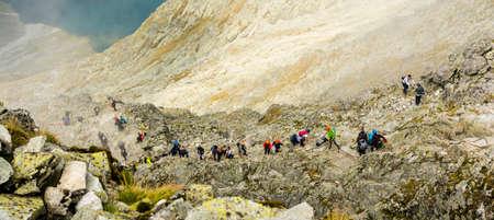 Palenica Bialczanska, Poland - September 08, 2018: Tourists climbing up to the popular Rysy peak. Tatra Mountains. Publikacyjne
