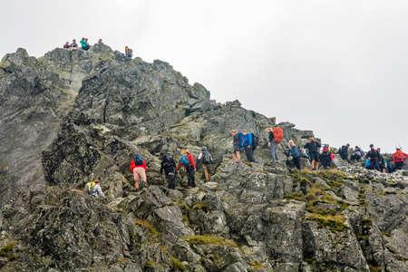 Palenica Bialczanska, Poland - September 08, 2018: Many tourists despite the poor weather on the way to the popular Rysy peak. Tatra Mountains.