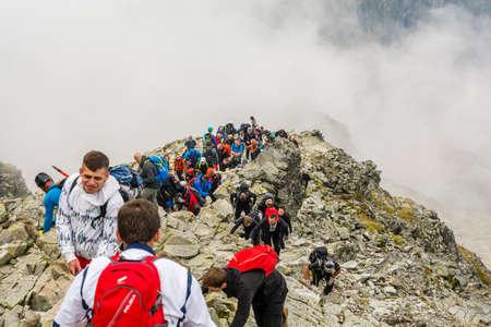 Palenica Bialczanska, Poland - September 08, 2018: Many tourists on the way to the popular Rysy peak. Tatra Mountains.