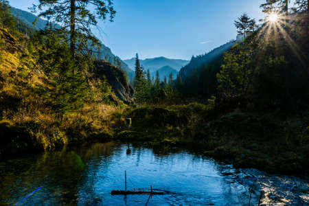 A fabulous and charming forest landscape and karst spring in the valley.