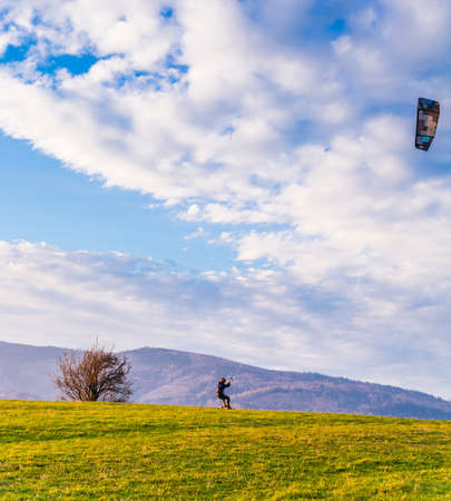 Wegierska Gorka, Poland - November 11, 2018: Land kiteboarding - Landboard rider during dynamic driving.