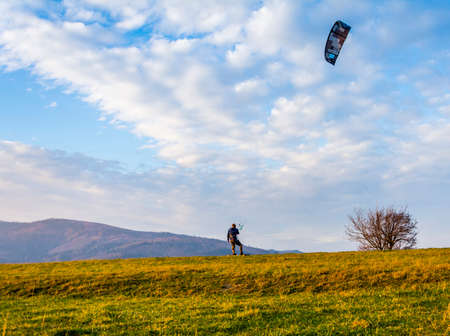 Wegierska Gorka, Poland - November 11, 2018: Land flyboarding - the boy rides in the clearing in the mountains in the strong wind.