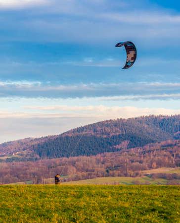Wegierska Gorka, Poland - November 11, 2018: Kite landboarding. Landboard rider rides using the C-shape kite.