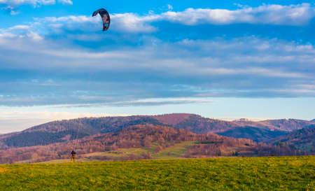 Wegierska Gorka, Poland - November 11, 2018: In the mountains there are good conditions for practicing extreme sport - Kite landboarding.